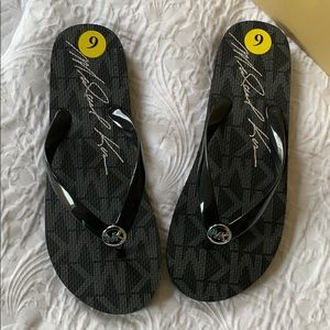 New Michael Kors flip flops size 9 black